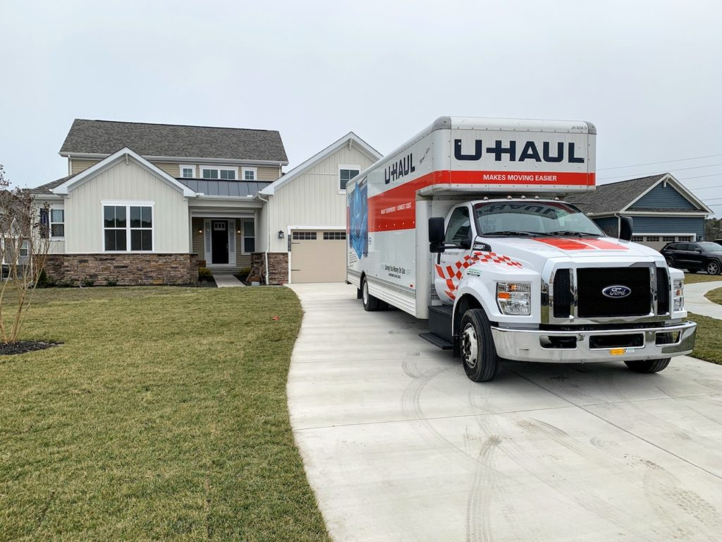 26' U-Haul Ford F-650 In Front of House